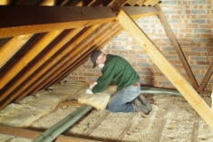 Loft insulation being installed