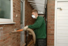 Cavity wall insulation being installed