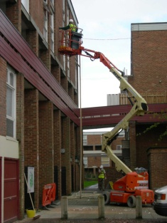 Cavity wall being installed in block of flats