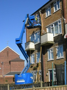 Cavity wall insulation being installed in block of flats